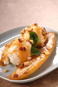 Banana with vanilla ice cream, caramel sauce and hazelnuts