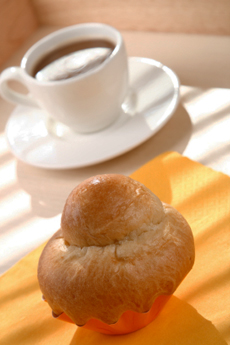 morning breakfast on serving tray french Brioche and white cup o