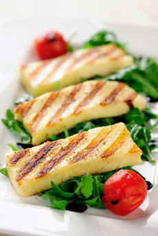 Grilled Halloumi cheese on rocket salad