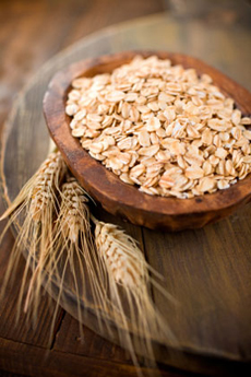 Nutritious rolled oats in a rustic setting.  Shallow dof